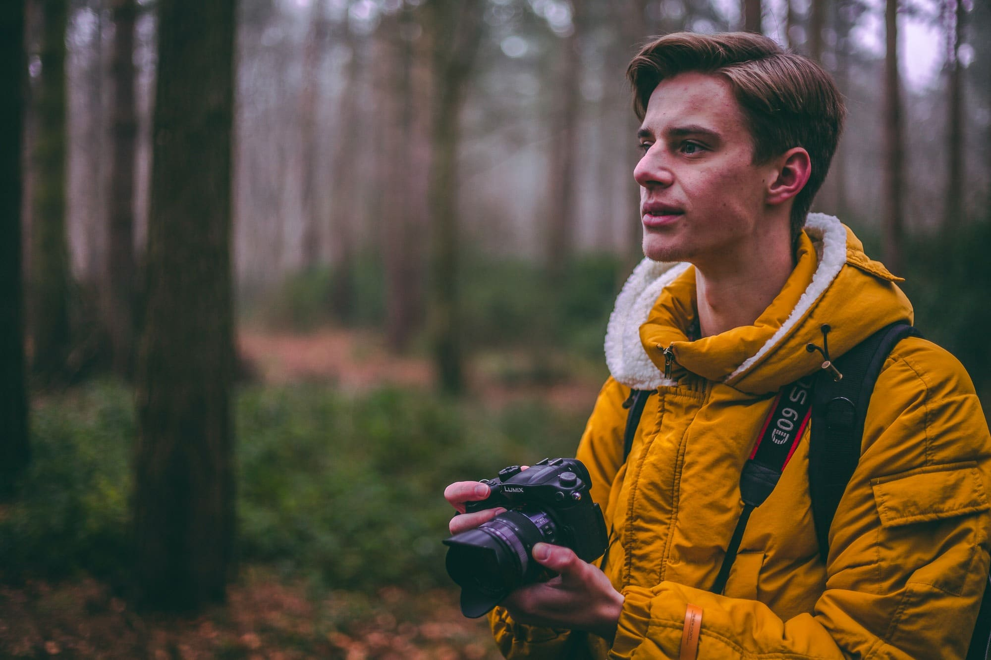 travel photographer in the forest